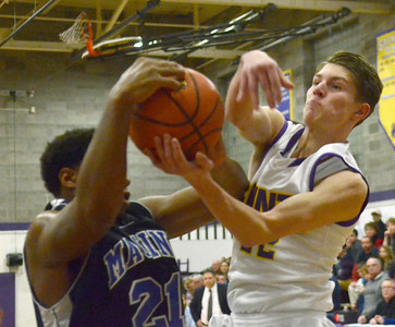 Ed Burke - The Saratogian 12/27/13 Saratoga Central Catholic's Ryan Czarnecki battles for a rebound with Bishop Maginn's JaQuan Jones during Friday's action in Saratoga Central Catholic's Christmas basketball tournament.