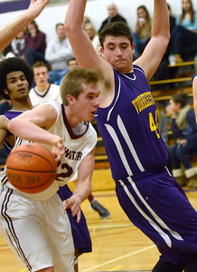 Ed Burke - The Saratogian 12/27/13 Stillwater's Schuyler Radliff back passes the ball while blocked by Voorheesville's Joe Vogel during Friday's action in Saratoga Central Catholic's Christmas basketball tournament.
