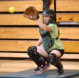 Ed Burke - The Saratogian 04/02/14 Greenwich catcher Samantha Whitehouse practices with the team Wednesday in the school's gym.