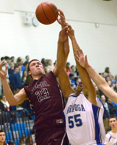 Ed Burke - The Saratogian 01/10/14 Burnt Hills-Ballston Lake's Austin Nydegger grabs a rebound ahead of Saratoga's Jesse Alexander during Friday's game at Saratoga.