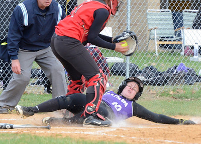 Ed Burke - The Saratogian 04/23/14 Ballston's Payton Witalec beats the throw to Guilderland's Gabby Marino and scores from third on a bunt by Maddy Fitzgerald during Wednesday's game at Ballston Spa.