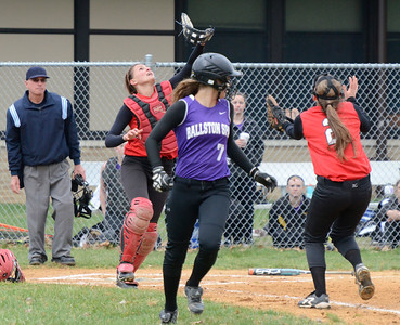 Ed Burke - The Saratogian 04/23/14 Double coverage by Guilderland catcher Gabby Marino and Taylor Tewksbury means an out on Ballston's Sam Pellerin who popped up in the 2nd inning.