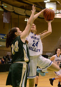 Ed Burke - The Saratogian 03/08/14 Hoosic Valley's Lauren Madigan goes up for a shot as Northern Adirondack's Alexis Boulrice tries to block during Hoosic's Class C regional win Saturday in Troy.