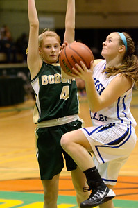 Ed Burke - The Saratogian 03/08/14 Hoosic Valley's Sam Carlo goes up for a shot as Northern Adirondack's Jillian Scott tries to block during Hoosic's Class C regional win Saturday in Troy.