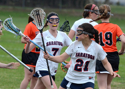 Ed Burke - The Saratogian 04/22/14 Saratoga's Caroline Kelly (7) and Taylor Murphy work their position during Tuesday's varsity lacrosse game versus Bethlehem at Saratoga.