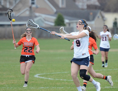 Ed Burke - The Saratogian 04/22/14 Saratoga's Hanna Wise passes the ball during Tuesday's varsity lacrosse game against Bethlehem at Saratoga.