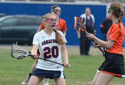 Ed Burke - The Saratogian 04/22/14 Saratoga's Sarah Winters guards Bethlehem's Maggie Ball during Tuesday's varsity lacrosse game at Saratoga.