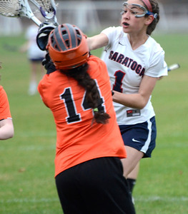Ed Burke - The Saratogian 04/22/14 Saratoga's Maria Zinter scores past Bethlehem goalie MaryKate McDonough during Tuesday's varsity lacrosse game at Saratoga.