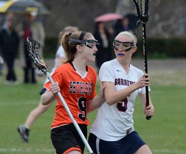 Ed Burke - The Saratogian 04/22/14 Saratoga's Lindsay Rutz guards Bethlehem's Sydney Klugman during Tuesday's varsity lacrosse game at Saratoga.