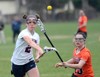 Ed Burke - The Saratogian 04/22/14 Saratoga's Molly Kern takes a shot on goal as Bethlehem's Abigail McDonald reaches to block during Tuesday's varsity lacrosse game at Saratoga.