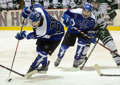 Ed Burke - The Saratogian 02/25/14 Saratoga's Josh Dagle tries to backhand the puck as Devin Coffey looks on during Tuesday's loss to Shen.