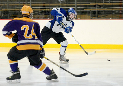 Ed Burke - The Saratogian 02/19/14 Saratoga's Grayson Rieder takes a shot on goal as CBA's Nicholas Makarowsky looks on during sectional action Wednesday in Saratoga.