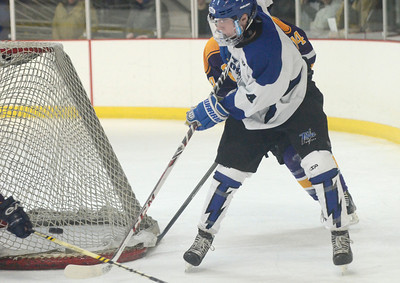 Ed Burke - The Saratogian 02/19/14 Saratoga's Jack Rittenhouse tries to center the puck during sectional action Wednesday against CBA in Saratoga.