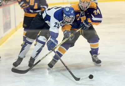 Ed Burke - The Saratogian 02/19/14 Saratoga's Josh Dagle reaches for the puck while battling with CBA's Nick Makarowsky during sectional action Wednesday in Saratoga.