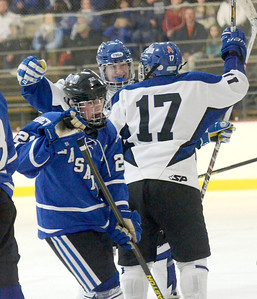 Ed Burke - The Saratogian 02/21/14 Saratoga's Jack Rittenhouse, facing, congratulates Grayson Rieder on his first period goal over La Salle during Friday's playoff matchup in Saratoga.