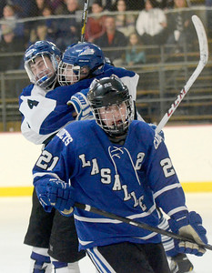 Ed Burke - The Saratogian 02/21/14 Dejected glance by La Salle's Nolan Brendese contrasts with the celebration behind after Grayson Rieder scored in the first period during Friday's playoff matchup in Saratoga.