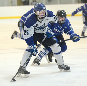 Ed Burke - The Saratogian 02/21/14 Saratoga's Elliott Hungerford takes aim as La Salle's Nolan Brendese closes in during Friday's playoff hockey matchup in Saratoga.