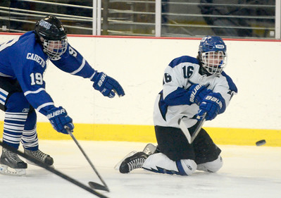 Ed Burke - The Saratogian 02/21/14 Saratoga's Cam McCall centers the puck after tangling with La Salle's Peter Hamlin during Friday's playoff matchup in Saratoga.