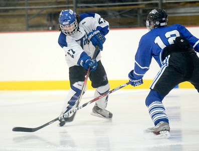 Ed Burke - The Saratogian 02/21/14 Saratoga's JT Rafferty shoots into defense by La Salle's Ben Gardenier during Friday's playoff matchup in Saratoga.