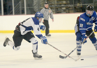 Ed Burke - The Saratogian 02/21/14 Saratoga's Jack Rittenhouse duels with La Salle's Ben Gardenier during Friday's playoff matchup in Saratoga.