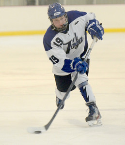 Ed Burke - The Saratogian 02/21/14 Saratoga's Isaac Fisher takes a slapshot against La Salle during Friday's playoff matchup in Saratoga.