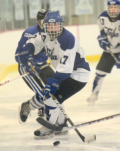 Ed Burke - The Saratogian 02/21/14 Saratoga's Grayson Rieder moves the puck against La Salle during Friday's playoff matchup in Saratoga.