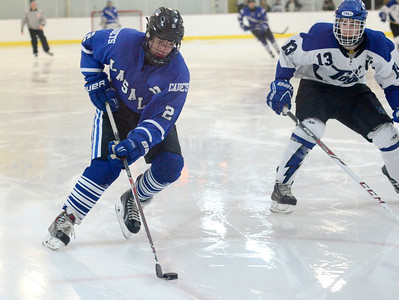 Ed Burke - The Saratogian 02/21/14 La Salle's Chris Hunt moves the puck during Friday's playoff matchup in Saratoga.