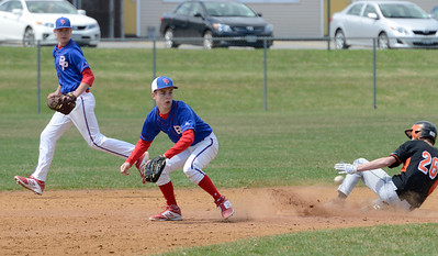 Ed Burke - The Saratogian 04/19/14 Schuylerville's Garrett Wysocki is safe at second as Broadalbin-Perth's Brett Getman fields the throw during Saturday's game at Schuylerville.