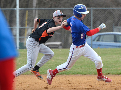Ed Burke - The Saratogian 04/19/14 Schuylerville's Tanner Dunkel tags out Broadalbin-Perth's Brett Getman during Saturday's game at Schuylerville.