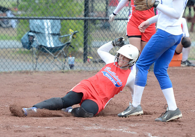 Ed Burke - The Saratogian 04/29/13 South High's Jill Ostrander scores from third on a pased ball during Tuesday's game at Moreau Rec Park.