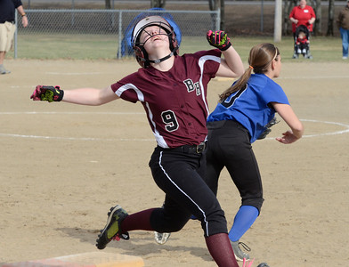 Ed Burke 04/25/14 Despite her best effort, Burnt Hills-Ballston Lake's Brittany Ryan can't beat the throw to Saratoga's Joelie Flynn during Friday's varsity softball matchup versus Saratoga at Veterans Memorial Park.