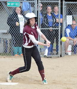 Ed Burke 04/25/14 Burnt Hills-Ballston Lake's Sienna Duff singles in the 7th during Friday's varsity softball matchup versus Saratoga at Veterans Memorial Park.