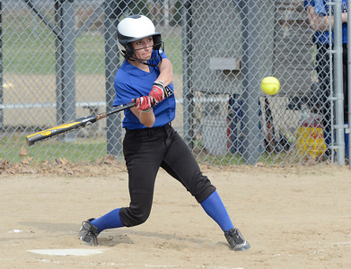 Ed Burke 04/25/14 Saratoga's Joelie Flynn pops out after connecting with this pitch during Friday's varsity softball matchup against Burnt Hills at Veterans Memorial Park.