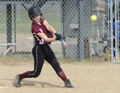 Ed Burke 04/25/14 Burnt Hills-Ballston Lake's Erin Sgambelluri connects for a base hit during Friday's varsity softball matchup versus Saratoga at Veterans Memorial Park.