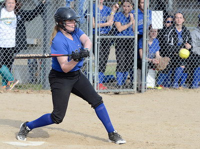Ed Burke 04/25/14 Saratoga's Sara Willner-Giwerc and Cierra McFarland score after teammate Bailey Motola connects with this pitch during Friday's varsity softball matchup against Burnt Hills at Veterans Memorial Park.