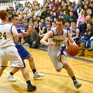 Ed Burke - The Saratogian 02/19/14 Saratoga Central Catholic's Brian Hall drives the ball towards the basket during Wednesday's Sectional matchup against Hadley-Luzerne.