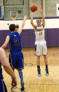Ed Burke - The Saratogian 02/19/14 Saratoga Central Catholic's Brian Hall tries for three during Wednesday's Sectional matchup against Hadley-Luzerne.
