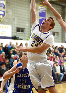 Ed Burke - The Saratogian 02/19/14 Saratoga Central Catholic's JR Hmura gets two for the Saints during Wednesday's Sectional matchup against Hadley-Luzerne.