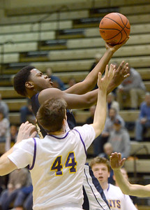 Ed Burke - The Saratogian 02/22/14 Rensselaer's LaVontae Armwood goes to the basket during Saturday's Section ll Class C quarter-final at Hudson Valley Community College.
