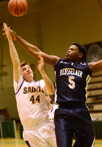 Ed Burke - The Saratogian 02/22/14 Saratoga Central Catholic's Mike Naughton is fouled by Rensselaer's LaVontae Armwood during Saturday's Section ll Class C quarter-final at Hudson Valley Community College.