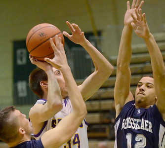 Ed Burke - The Saratogian 02/22/14 Saratoga Central Catholic's Evan Pescetti is pressured by Rensselaer's Tyler Oliver (1) and Mike Gibson during Saturday's Section ll Class C quarter-final at Hudson Valley Community College.