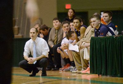 Ed Burke - The Saratogian 02/22/14 Rensselaer coach Matt Nunziato watches his team during Saturday's Section ll Class C quarter-final at Hudson Valley Community College.