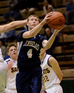 Ed Burke - The Saratogian 02/22/14 Rensselaer's Jake Forgea goes to the basket during Saturday's Section ll Class C quarter-final at Hudson Valley Community College.