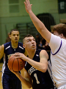 Ed Burke - The Saratogian 02/22/14 Rensselaer's Tyler Oliver looks for options as Saratoga Central Catholic's Keegan Murphy blocks during Saturday's Section ll Class C quarter-final at Hudson Valley Community College.