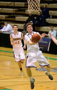 Ed Burke - The Saratogian 02/22/14 Saratoga Central Catholic's Luke Spicer finds clear sailing to the basket during Saturday's Section ll Class C quarter-final versus Rensselaer at Hudson Valley Community College.