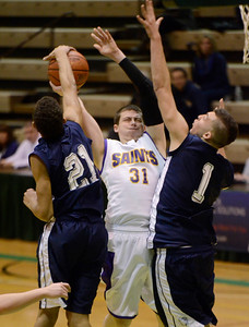 Ed Burke - The Saratogian 02/22/14 A shot by Saratoga Central Catholic's Jake Van Patten is stuffed by rensselaer's Winston Edmonds during Saturday's Section ll Class C quarter-final at Hudson Valley Community College.