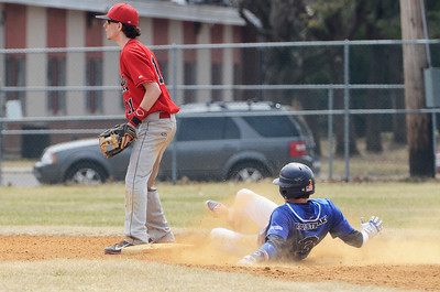 Erica Miller @togianphotog - The Saratogian:  Saratoga Springs High School held their first baseball home game on Monday afternoon at East Side Rec, April 14th, 2014, against Niskayuna. Saratoga's Zach Guzi slides safely into second base, Nisky's Taylor Parks on base.