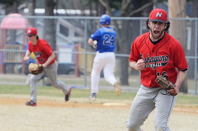Erica Miller @togianphotog - The Saratogian:  Saratoga Springs High School held their first baseball home game on Monday afternoon at East Side Rec, April 14th, 2014, against Niskayuna. Niskayuna's pitcher Michael Gabriele celebrated after their third out.