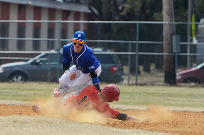 Erica Miller @togianphotog - The Saratogian:  Saratoga Springs High School held their first baseball home game on Monday afternoon at East Side Rec, April 14th, 2014, against Niskayuna. Nisky's Garrett Whitley sides into second base against Saratoga's Zach Guzi.