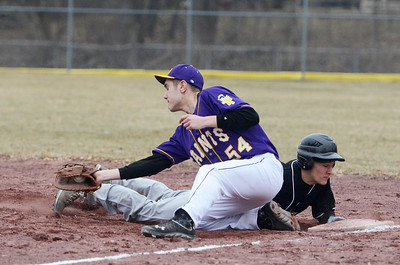 Erica Miller @togianphotog - The Saratogian:   On Monday April 7th, 2014 Saratoga Central Catholic held their first homegame against Canajoharie at the West Side Rec. Canajoharie's Dillan Veeder slides safely back to first base against Saratoga's Kyle Bailey.